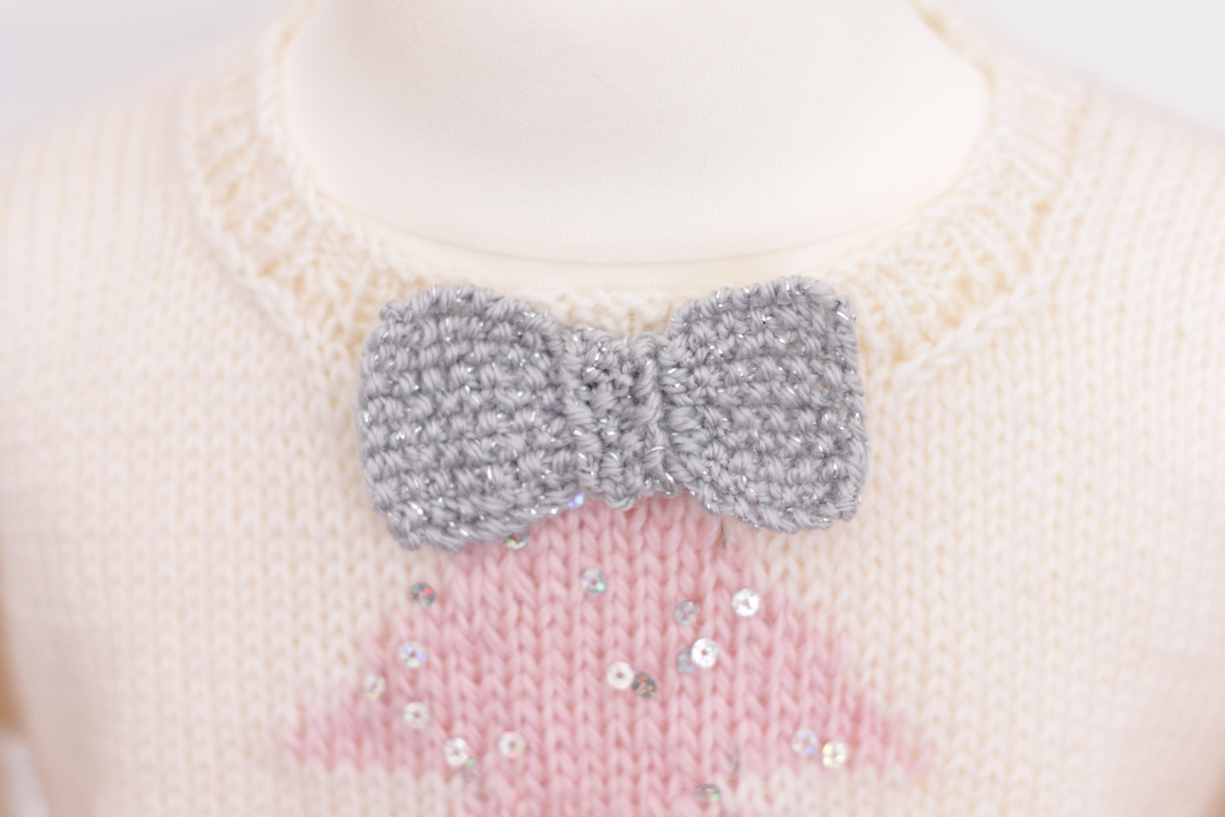 christmas sweaters tree bow close up JANE BURNS
